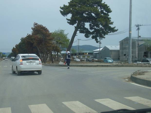 In many areas electricity is still unavailable and the traffic lights have malfunctioned.  Here, police officers from Hyogo prefectures in western Japan are directing traffic.
