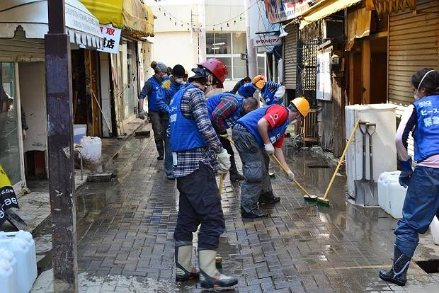 Paul and colleagues cleaning the Ishinomaki streets in April, 2011