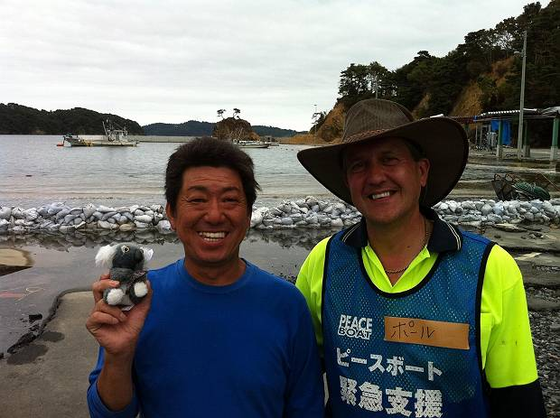 Paul gives a koala to a local friend and fisherman